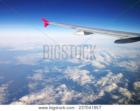 Aircraft Wing And The Sky Above The Clouds.