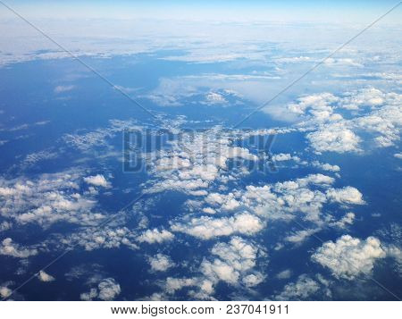 View High Above The Clouds Covered The Air Space Below.