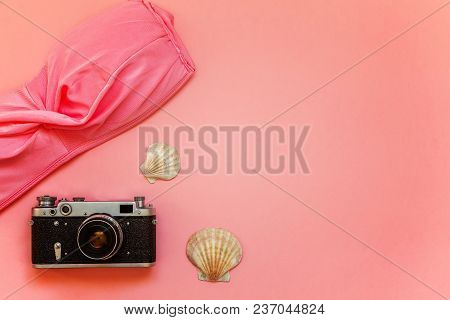 Flat Lay With Bikini, Vintage Film Photo Camera And Shell On Pink Colourful Pastel Color Trendy Mode