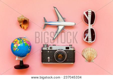 Flat Lay With Plane, Vintage Film Photo Camera, Sunglasses, Globe And Shell On Pink Colourful Pastel