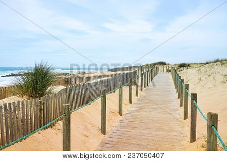 Wooden Path On The Atlantic Beach With Ocean View. Portugal