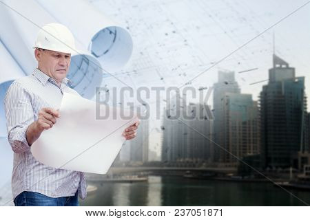 An Engineer Study Blueprints Against Urban Background In Collage