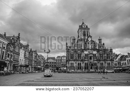 Delft, Western Netherlands - June 29, 2017. Square And Gothic City Hall Building On Cloudy Day In De