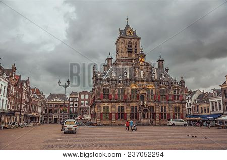 Delft, Western Netherlands - June 29, 2017. People On Market Square And Decorated Gothic City Hall B