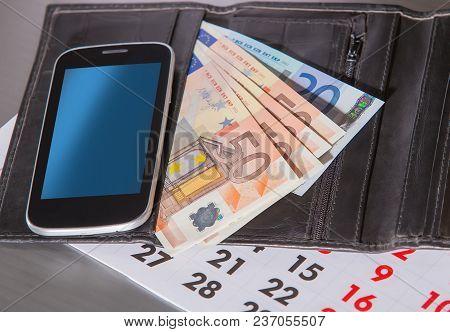 Euro Banknotes Purse Calendar Mobilephone Closeup Photo