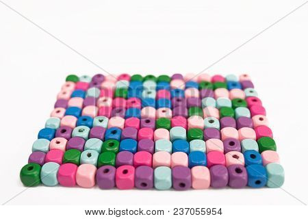 Colored Wooden Cubes On A White Background, Isolated