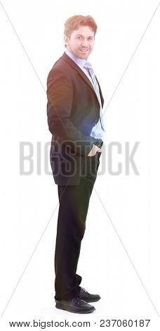 in full growth. side view.smiling handsome businessman