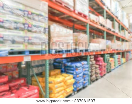Blurred Rack Of Dog And Cat Food At Wholesale Retail Store