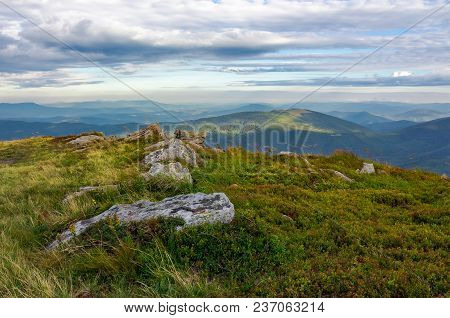 Rocky Formations On The Grassy Hills. Beautiful Mountainous Scenery In Late Summer. Colorful Grassy