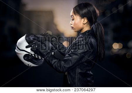 Black Female Motorcycle Rider Or Race Car Driver Wearing A Racing Helmet And Leather Jacket. Part Of
