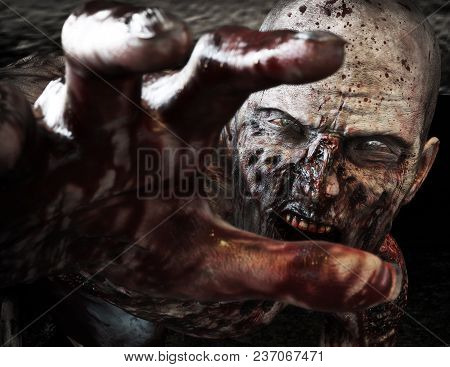 Close-up Portrait Of A Horrible Scary Zombie Attacking, Reaching For Its Unsuspecting Victim . Horro
