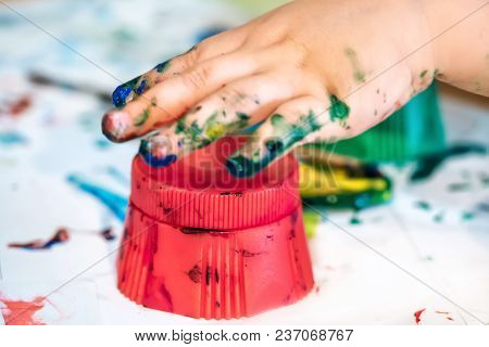Hands Of Child Girl Boy Dirty In Childrens Finger Paint Studying Drawing Art
