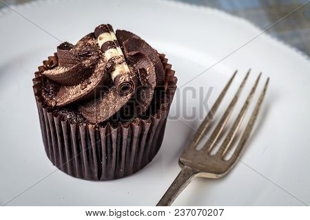 Chocolate Cupcake On White Plate With Fork