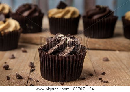 Hero Chocolate Cupcake On Wooden Table With Chocolate Chip