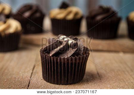 Hero Chocolate Cupcake On Wooden Table Top