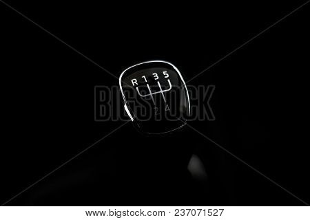 Manual Transmission Gear Shift, On Dark Backgroun.