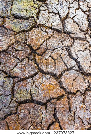 Cracked Brown Clay Ground, Drought Land Background.