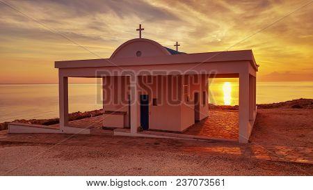 Cyprus, Mediterranean Sea Coast. Agioi Anargyroi Church At Cape Greco At Sunrise
