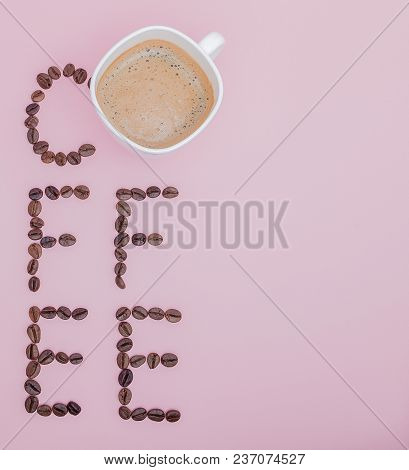 Text Made Of Coffee Beans: Coffee. Texture Of The Coffee Beans On A Pink Background. Smelly, Saturat