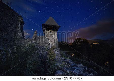 Ruins Of Nevitsky Castle Near Uzhgorod, Ukraine With A Lot Of Shiny Stars On The Dark Blue Sky
