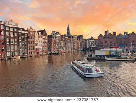 City scenic from the city Amsterdam in the Netherlands at sunset