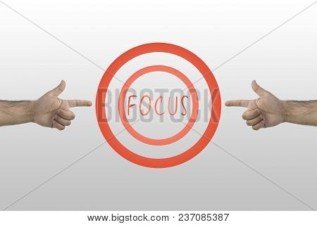 Focus Concept. Business Concept. Two Hands Pointing To Drawn Aim With Text In The Center: Focus.