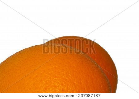 Bright Colored Sides Of Two Oranges Slightly Resembling Human Buttocks With Cellulite, On A White Ba
