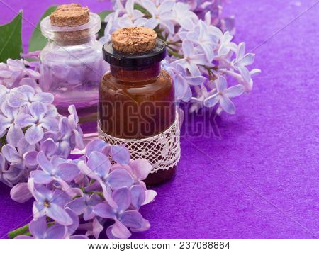 cosmetics with lilac flowers