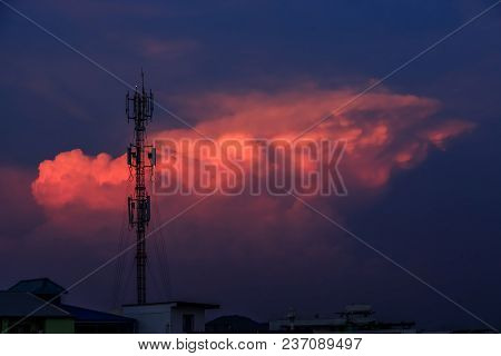 Silhouette Signal Antenna Tower At Sunset Sky