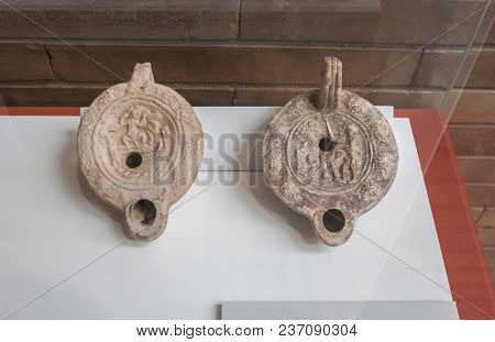 Merida, Spain - December 20th, 2017: Two Clay Oil Lamps With Erotic Motifs At National Museum Of Rom