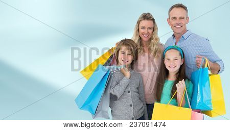 Family with shopping bags against blurry blue abstract background