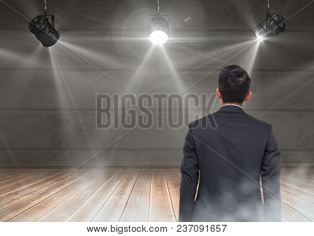 Back of Man Looking at stage lights