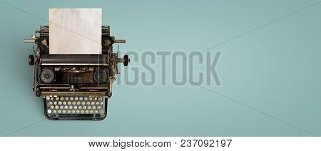 Vintage Typewriter Header With Old Paper. Retro Machine Technology - Top View And Creative Flat Lay