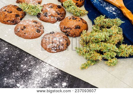 Cookies With Cannabis And Buds Of Marijuana On The Table. Concept Of Cooking With Cannabis Herb. Tre