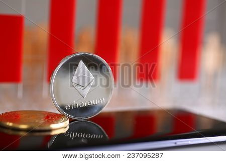 Silver Ethereum Coin Is Lying On Cellphone Surface Display Closeup. Future Web Ico New Money Type Et