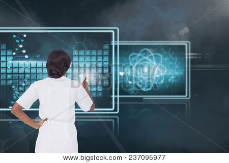 Woman doctor interacting with medical interfaces