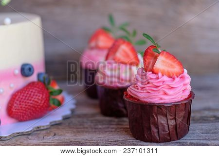 Beautiful Wedding Cupcakes With White Pink Cream And Strawberries
