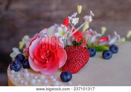 Home Wedding White Pink Cake With Cheese Cream, Strawberries And Blueberries Decorated With Flowers