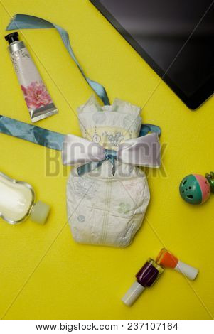 Contents Of A Woman's Bag On Yellow Background.