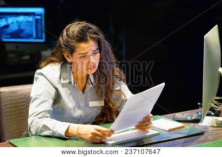 A Woman-reception Hotel Worker Reading Negative News In Letter. Shocked Beauty Girl Business Manager