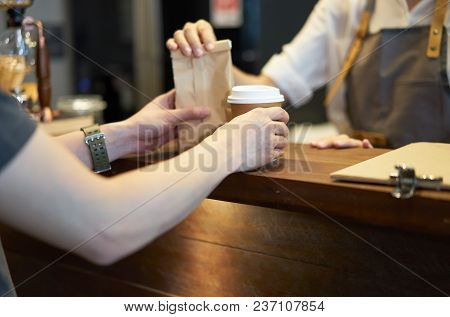 Barista Serving Customer At Coffee Shop.takeaway And Service Concept, Small Business. Owner Business