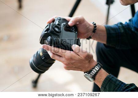 A man checking camera record