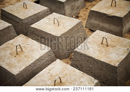 Many Concrete Blocks Arranged In Rows For A Building Foundation. Construction Site Groundwork Backgr