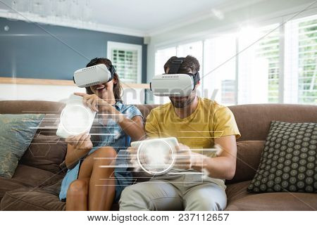 Couple in VR headset playing with interfaces