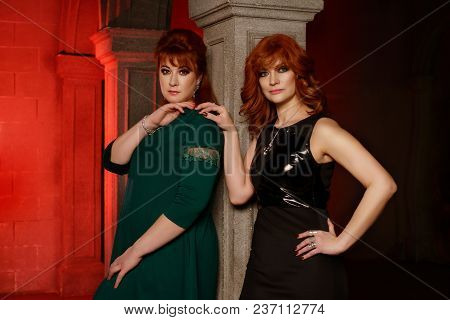 Beautiful Girls Dressed In Gothic Style In Castle Interior