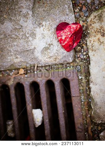 The Broken Heart, Image Of A Crumpled Red Foil On The Floor, Crushed And Broken