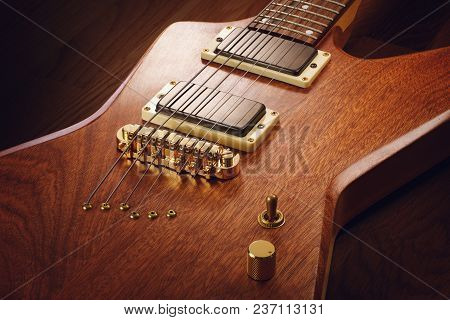 Close Up On The Body Of Custom Electric Guitar With Natural Finish, Dark Wooden Background
