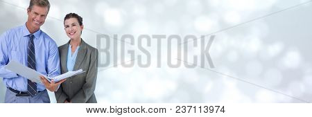 Business people holding files and folders with blurred sparkling background