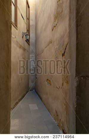 Dead End Narrowing Isle With Stone Grunge Walls And Lantern, Cairo, Egypt
