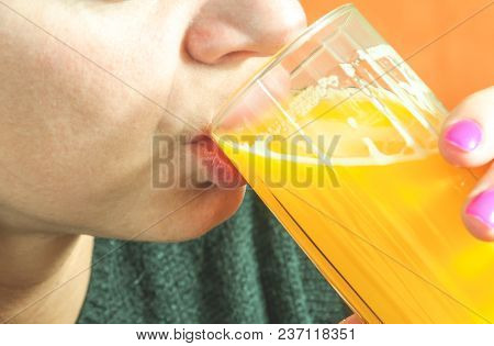 Close Up Of Girls Face And Lips Drinking Orange Juice From The Glass As Refreshment, Real People, Se